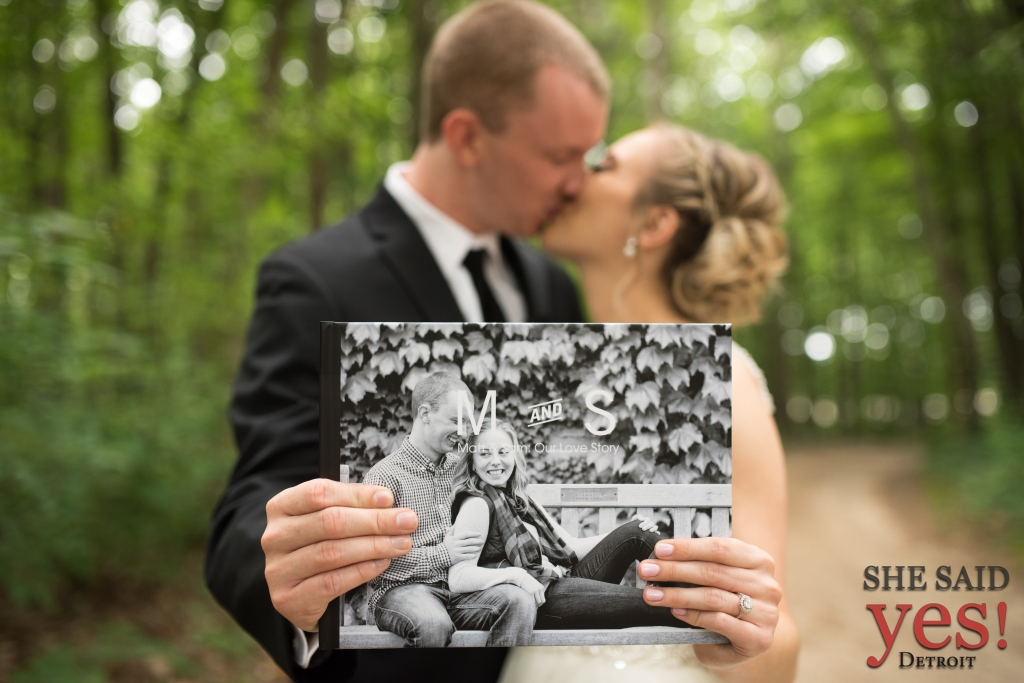 bride and groom share memory book